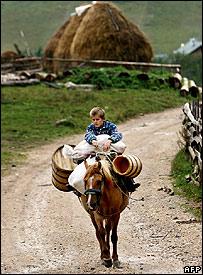 A Kosovan boy astride a horse