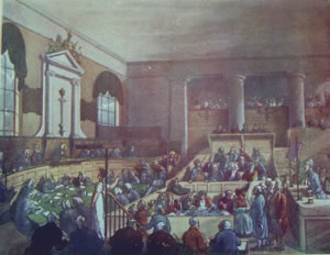 Old Bailey Courtroom, 1809 by Augustus Pugin and Thomas Rowlandson.  A trial is in process.  There is a man testifying on the right;  jurors are seated in tiered boxes in the centre-rear;  spectators are behind them;  council are seated on the left;  and above them the judges are seated on a raised platform, below the windows and the sword of justice on the wall. From W. H. Pyne and W. Combe, The Microcosm of London, or London in Miniature (3 vols, London, 1904), vol.2, facing page 212.  Reproduced courtesy of and with thanks to the University of Sheffield.