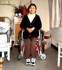 Picture: Ms Tang Shengli in her wheelchair at the hospital