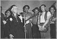 Photo of Dame Mary Gilmore performing with the Bushwhackers