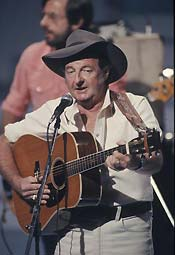 A photograph of Slim Dusty performing at the Australia Day Concert, 1984.