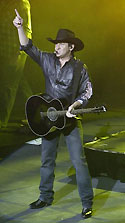 A photograph of Lee Kernaghan performing live on his 2006 Outback to the Beaches tour of Australia, Enmore, New South Wales, 24 November, 2006.