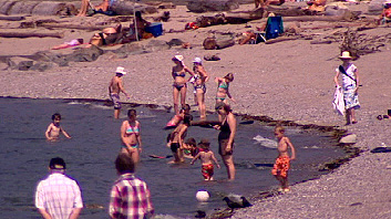 Vancouverites seek relief at Sunset Beach as more high-temperature records toppled.
