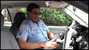 A Washington DC police officer consults his in-car computer