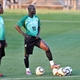 Ghana's midfielder Stephen Appiah (C) and midfielder Sulley Muntari (L) stand on the pitch as they t