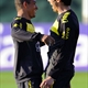 Brazil national team football player Kaka (R) reacts with teammate Gilberto Silva during a training
