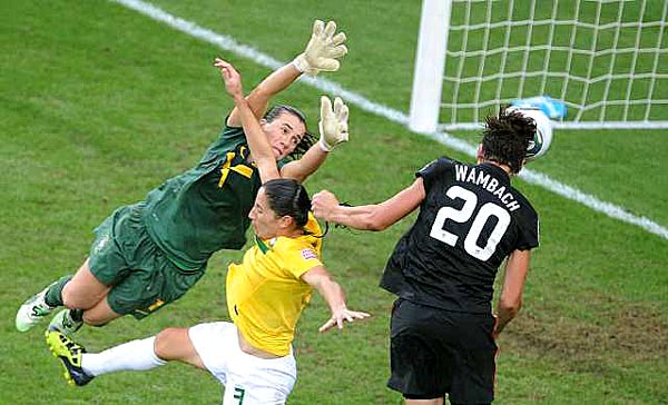 American striker Abby Wambach scores with a header past Brazil goalkeeper Andreia and defender Daiane at Rudolf Harbig Stadium in Dresden, Germany, on Sunday.