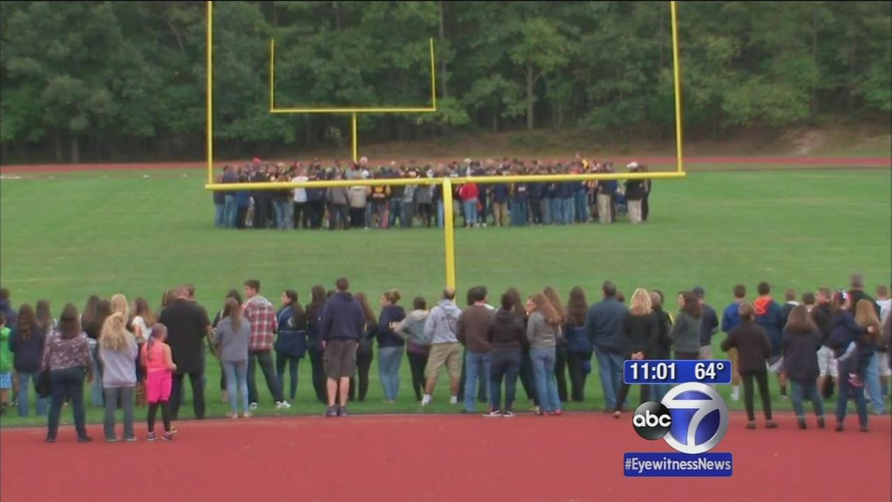 High school football player remembered during vigil