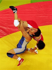 As expected, Japan ruled the women's debut of Olympic wrestling.  Kyoko Hamaguchi (blue) won bronze in the 72kg (158.5 lbs) division.