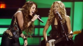 Miley Cyrus, left, and Sheryl