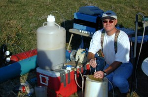 USGS scientist collecting water-quality samples during a hydrogen-consuming, push-pull injection test at the Norman Municipal Landfill Research Site, Okla. The test is used to determine what microbiological processes are active in the subsurface at ground-water contamination sites.