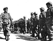 General Ridgway, commanding the 8th Army, reviews the French Battalion (Feb. 51).
