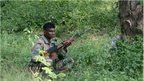 An Indian army soldier rests in undergrowth during an attack by militants on an army camp at Mesar in Samba District, some 20kms south-east of Jammu on September 26, 2013.