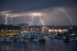 Lightning over Sovereign Harbour in Eastbourne. Southeast England is most at risk of thunderstorms tonight and tomorrow