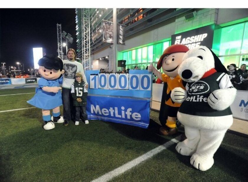 """John Hall, former New York Jets Kicker, joins MetLife, the MetLife Foundation and New York area football fans at """"Kicking it for Charlie Brown,"""" a November fundraiser for local food banks."""