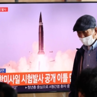 A TV broadcasting file footage of a North Korean missile test, in Seoul on Wednesday