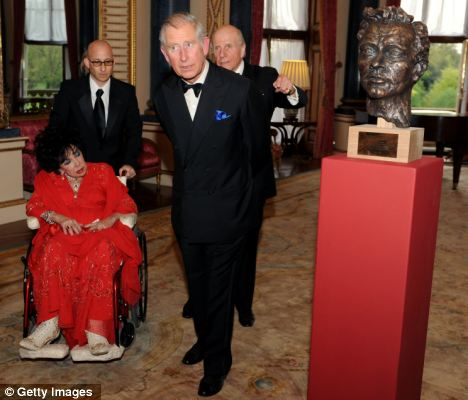 UK visit: Dame Elizabeth Taylor with Prince Charles at the recent unveiling of a bust of actor Richard Burton