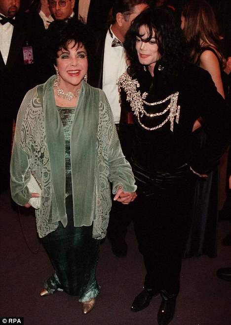 United in death: Taylor's funeral took place at tomb of her close friend Michael Jackson, in California yesterday