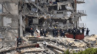 video: Miami building collapse: human remains found on site with 159 still missing - watch press conference live