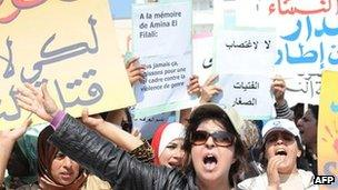 Protesters stage a sit-in outside a local court in Earache, Morocco, where a judge ordered 16-year-old Amina Filali, to marry the man who had raped her, in order to preserve her family's honour. She later committed suicide (15 March 2012)