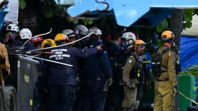Rescue workers at the scene of the collapsed Miami apartment block, June 2021