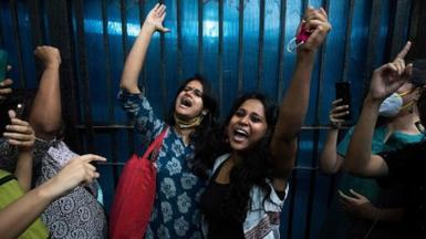 Student activists Natasha Narwal and Devangana Kalita outside Tihar prison, in New Delhi