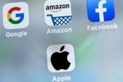 Les logos des applications mobiles de Google, Amazon, Facebook, Apple et Netflix, sur l'écran d'un téléphone, en2019.