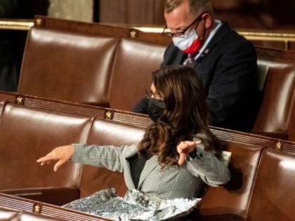 Rep. Lauren Boebert Unfurls Mylar Blanket at Biden Speech to Bring Attention to Biden's Border Crisis
