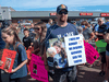 Nick Beaton, whose wife Kristen was killed in the April 2020 mass shooting, attends a march in Bible Hill, N.S. organized by families of victims last summer demanding an inquiry into the crimes that killed 22 people.
