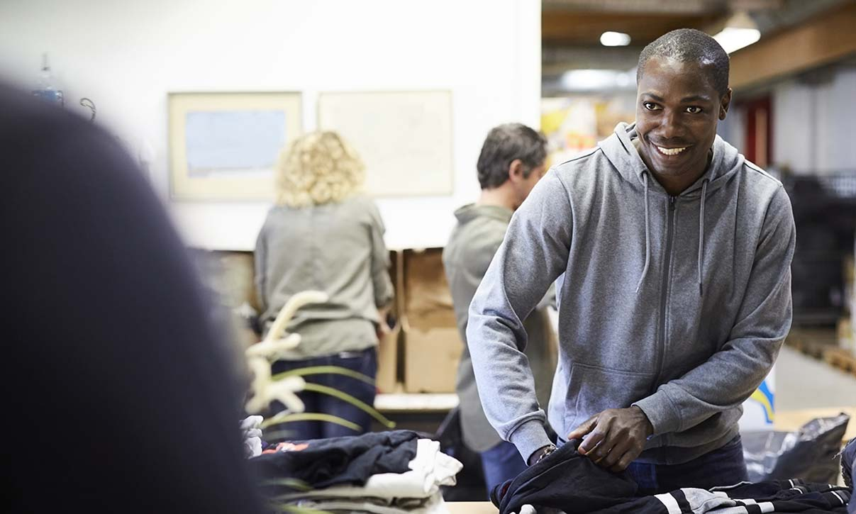 man working a clothing drive