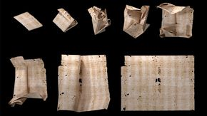 different stages of a letter being unfolded