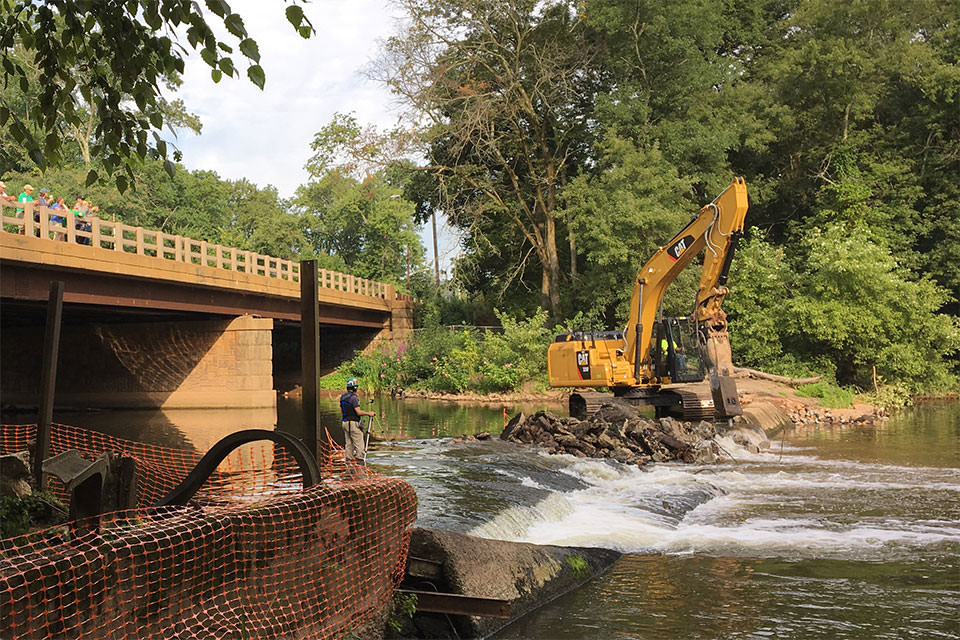 Construction equipment working to remove the Weston Mill dam on New Jersey's Raritan River.